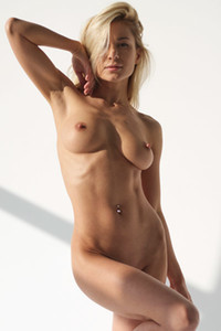 Glorious babe Darina L flaunts her sexy figure while posing naked