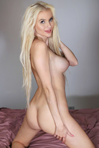 Alluring blonde bombshell shows us her nide enhanced tits and tight ass