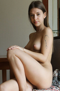 Sensual chick removes her dress and spreads her legs during a photoshoot