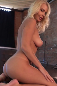 Blonde goddess Darina A with incredible body seductively posing on the chair for the camera