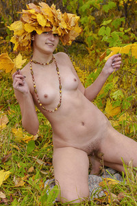 Maryanna exposes her all natural figure for the camera while posing naked outdoor