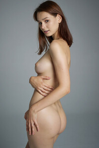 Beautiful Tasha sensually poses nude showing us her all natural assets